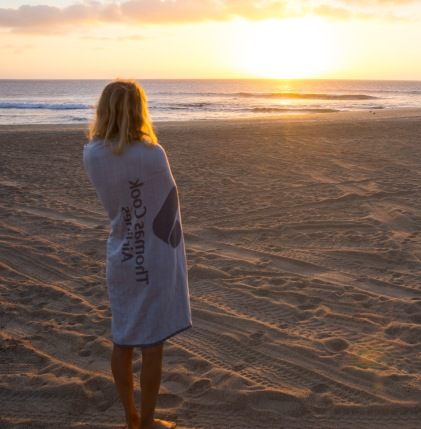 Checking the morning surf. Blanket: courtesy of Thomas Cook