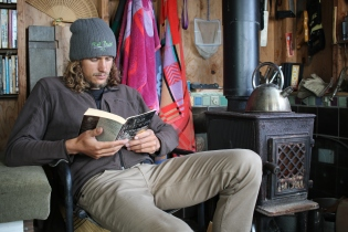 posing...er...reading by the fire